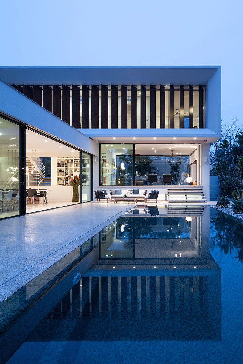 The swimming pool is the focal point of this home, and it's almost seamless in its integration, with it having no steps down to it from the kitchen and dining area.