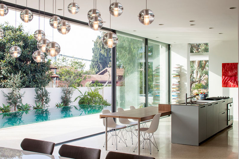 Large sliding glass doors next to the open plan kitchen and dining area add to the indoor/outdoor living aspect of this home.
