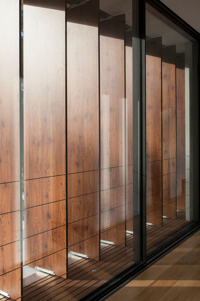 Teak louver panels have been used on the upper floor of this home, providing privacy and shade when needed.