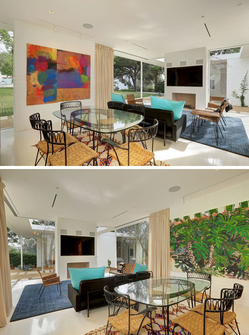 Between the living room and the kitchen of this small home is the dining room. Art has been positioned on both sides of the dining room, helping to anchor the area in the open floor plan.