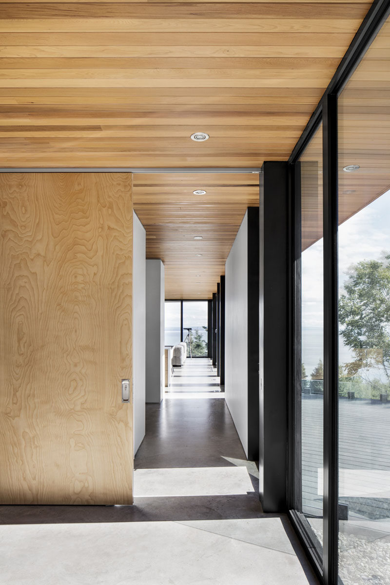 Western Cedar on the overhangs extend from the outside of this home through to the ceiling inside.