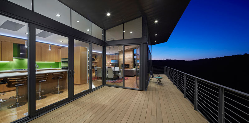 This balcony extends the living space of this home and during the day provides views of the ever changing trees depending on the season.