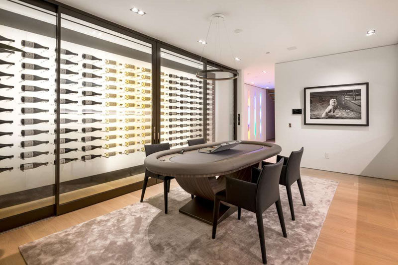 This wine wall is not your normal shelving unit...it is a 600-bottle, floating backlit wine cellar that opens with a thumbprint.