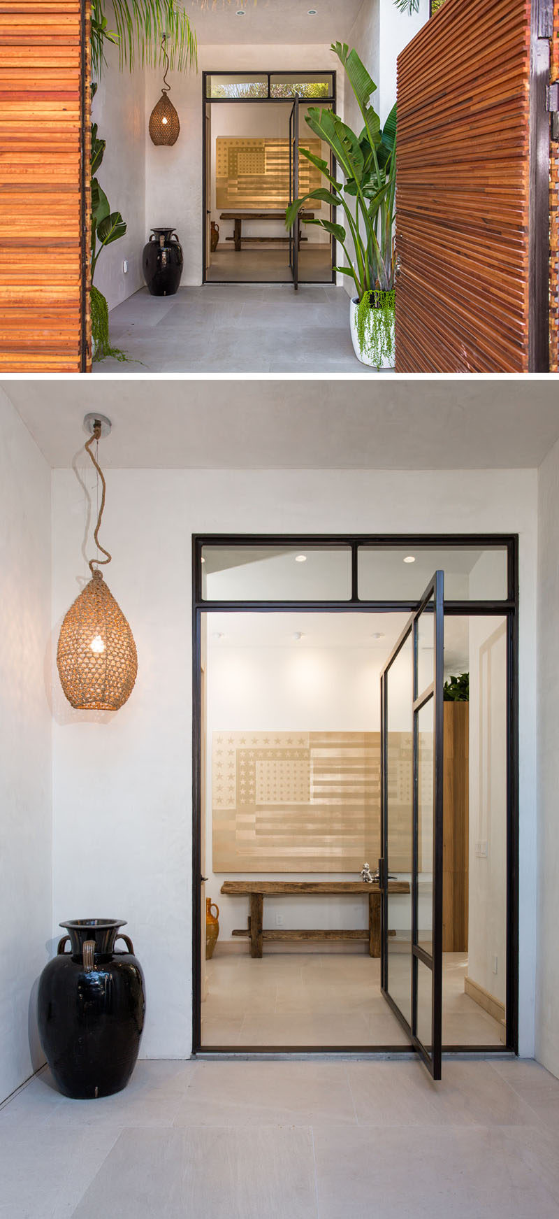 At the entrance to this Californian home, there's a glass pivoting door with black frame.