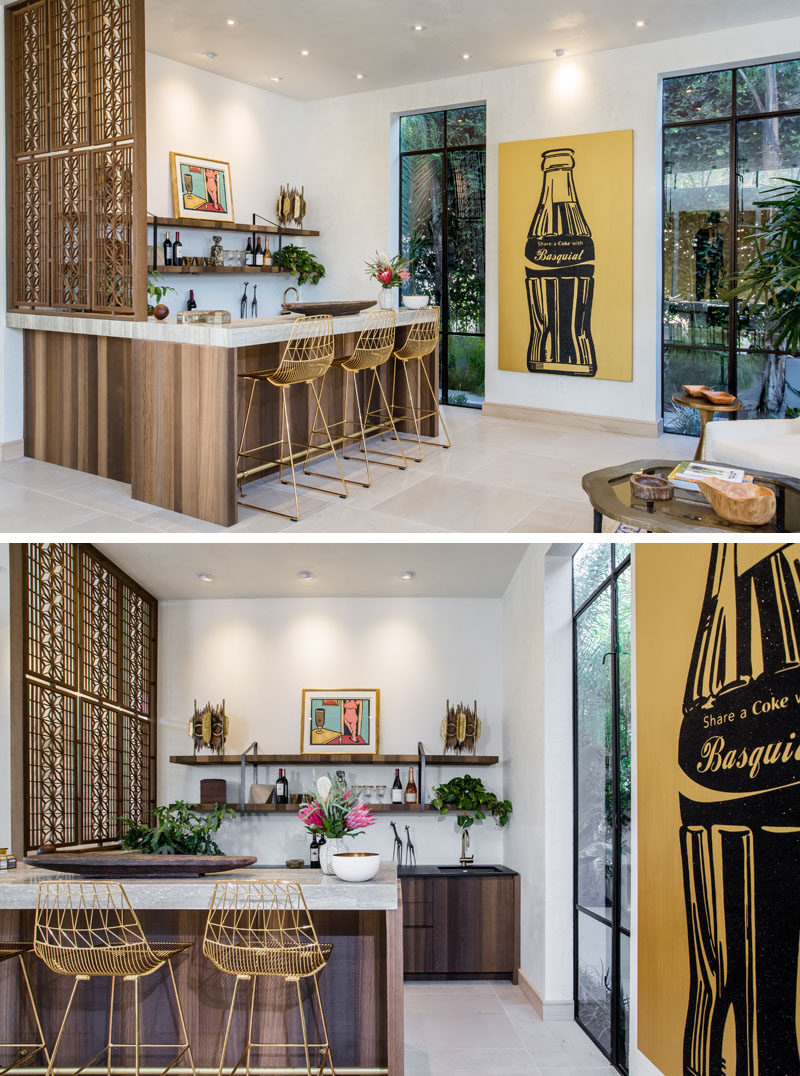 This U-shaped bar layout is great for creating a counter space that people can sit at while their cocktails are being prepared.