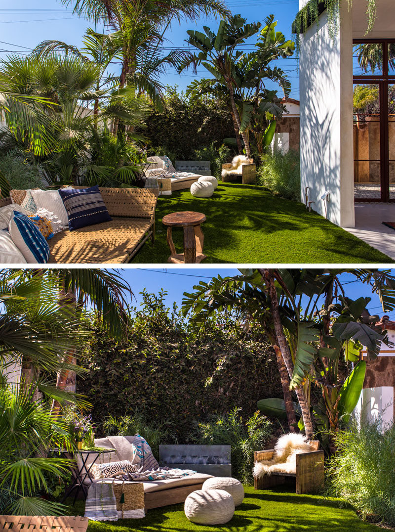 This backyard has been set up to have a variety of seating options and a water feature.