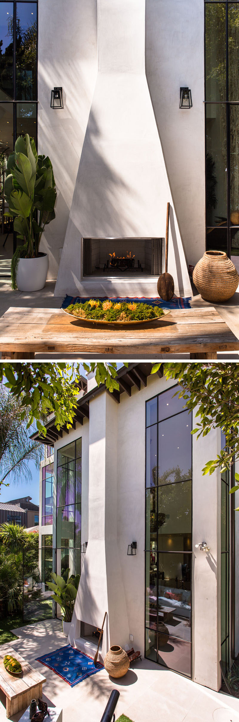 This home has a dramatic white outdoor fireplace with a chimney that runs the height of the home.