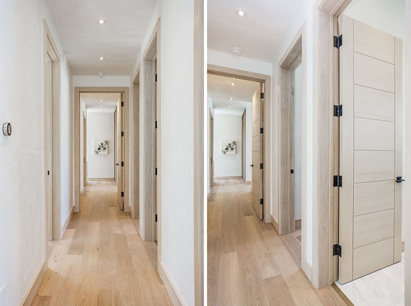 The hallways of this home have been kept light with the use of a light wood floor, doors and trim. The only dark touches are the door hinges and handles.