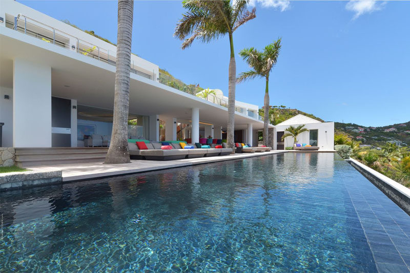 A large infinity edge swimming pool is located at the front of this villa, positioned for amazing views.