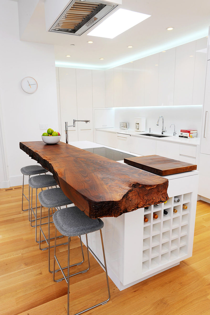 Kitchen Design Idea - 5 Unconventional Materials You Can Use For A Countertop // Live Edge Wood -- Slightly more rustic than butchers block counters, live edge wood is just as durable and even more unique. With their edges left untreated the and the pattern of the wood grains still visible, live edge wood countertops bring in a natural warmth that other materials can't.