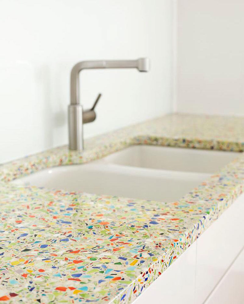 Kitchen Design Idea - 5 Unconventional Materials You Can Use For A Countertop // Recycled Glass -- Recycled glass countertops are just what they sound like - countertops made from recycled glass. Old glass materials, like bottles, windows, and beakers are crushed into tiny pieces and are either embedded into concrete or are held together with the help of a binding agent.