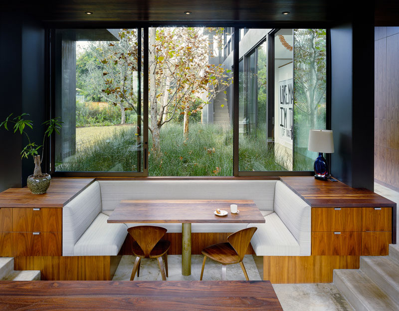 Dining Room Idea - Create A Built-In Dining Nook // This built-in dining nook has been sunken into the floor, with hidden drawers neatly tucked into the side. Large windows can be opened to let you feel like you are dining outdoors. #DiningNook #BuiltInDiningNook #BanquetteSeating #DiningRoom