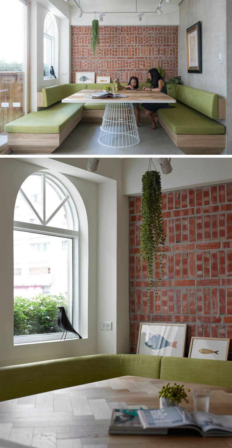 Dining Room Idea - Create A Built-In Dining Nook // Light wood and soft green cushions soften up the brick feature wall, and make this dining area a calm place to spend time eating or gathering around with friends and family.