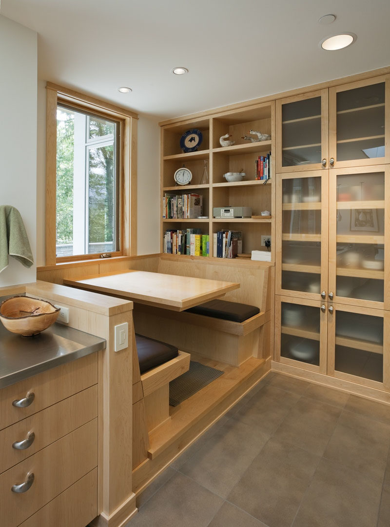 Dining Room Idea - Create A Built-In Dining Nook // Light wood and a large window help make this small dining nook a bright cozy spot. A wall of shelves and cabinets keeps everything at arms length. #DiningNook #BuiltInDiningNook #BanquetteSeating #DiningRoom