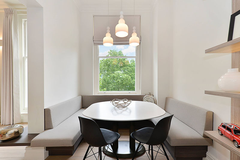 Dining Room Idea - Create A Built-In Dining Nook // Light fabric, white walls, and high ceilings make this large dining nook a bright and airy space, while additional chairs make sure there is room for everyone around the table. #DiningNook #BuiltInDiningNook #BanquetteSeating #DiningRoom