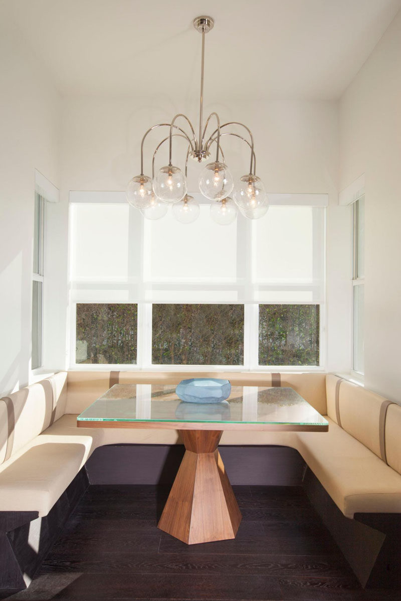 Dining Room Idea - Create A Built-In Dining Nook // Clean lines and a custom-built dining nook fill this space that can quickly go from the place where you have breakfast to the center of a dinner party. #DiningNook #BuiltInDiningNook #BanquetteSeating #DiningRoom