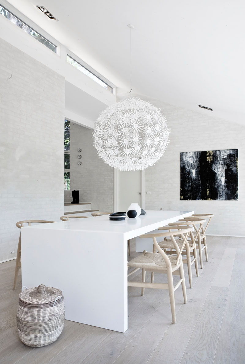 8 Lighting Ideas For Above Your Dining Table // A Single Pendant Light -- They come in such a huge variety of sizes, shapes, colors, finishes, and sub-styles.