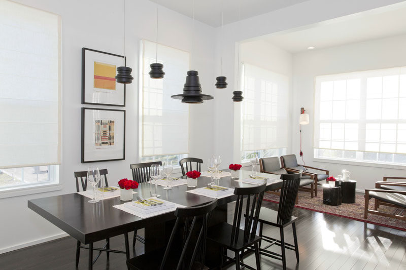 8 Lighting Ideas For Above Your Dining Table // Five Pendant Lights -- Hanging five pendant lights is a unique way to add a light source above your dining room table. It ensures that everyone at the table will be able to see their plates and adds a slightly more dramatic look to your space than one or even three pendant lights would.