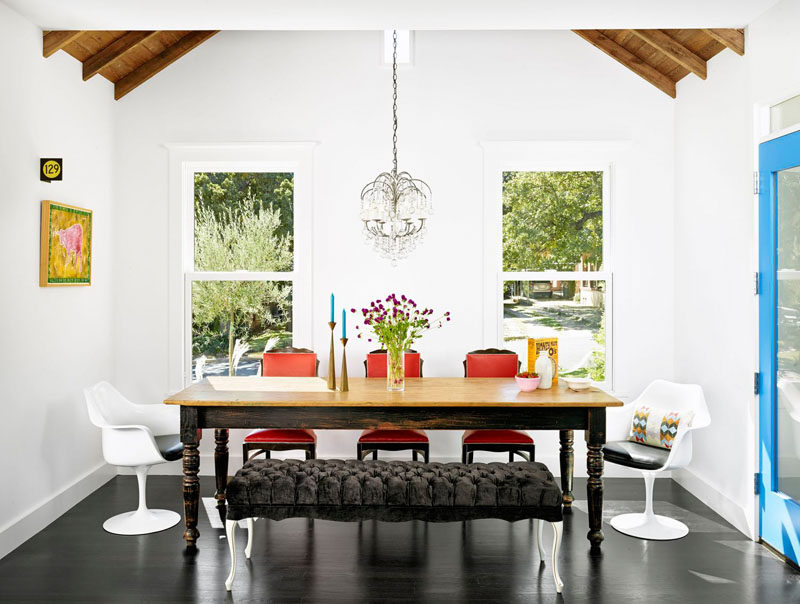 8 Lighting Ideas For Above Your Dining Table // Chandelier -- While chandeliers have a reputation for being over the top, glamorous, and not so subtle, it is possible to find ones that are in keeping with modern design. Exposed wires, matte finishes, and defined lines can all be incorporated into the design of a chandelier and make for a modern light fixture perfect for above the dining room table.