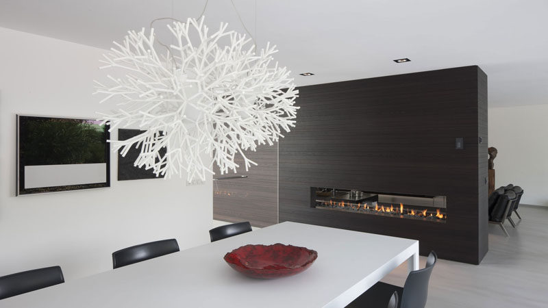 8 Lighting Ideas For Above Your Dining Table // Sculptural -- Using light fixtures made from unique materials or with an unusual design adds both light and art to your dining area.
