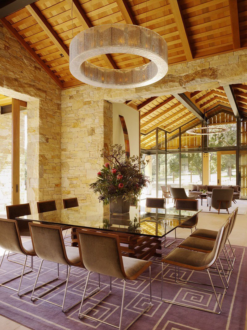 8 Lighting Ideas For Above Your Dining Table // Drum Lights -- Also known as halo pendant lights, ring pendant lights, and circular pendant lights, these light fixtures cast a diffused light onto your dining room table making it easy for everyone to see what's in front of them and creating a unique, ambient effect.
