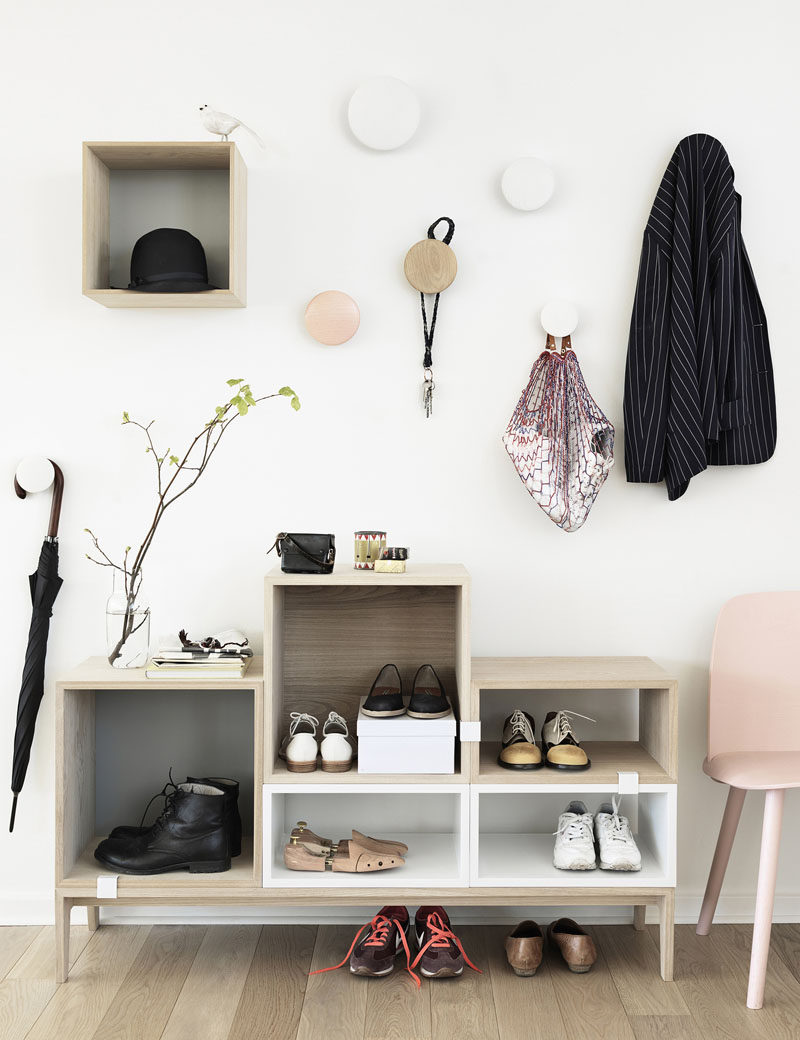 Interior Design Idea - What To Include When Creating The Ultimate Entryway // Shoe Storage -- Keep shoes under control with cabinets, racks or bins, so that you and your guests don't trip over them as you walk in the door and to keep your entryway always looking tidy.