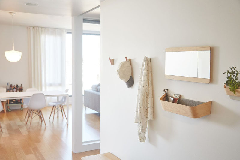 Interior Design Idea - What To Include When Creating The Ultimate Entryway // Catch-alls -- A nice dish for your keys, a wall mounted ledge, or a simple catch-all cubby give you a convenient place to put your daily essentials at the end of the day, so you know exactly where they are when you're all ready to head out later.