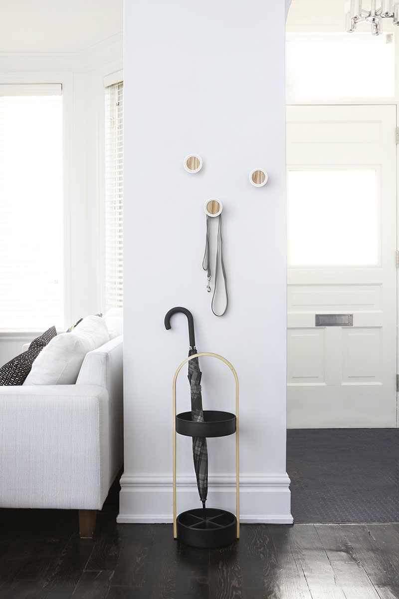 Interior Design Idea - What To Include When Creating The Ultimate Entryway // Umbrella Stand -- Rather than hanging your umbrella on a hook on the wall, where the water trickles down the wall, or just on the floor where you will have a puddle of water - add a simple umbrella stand to your entryway.