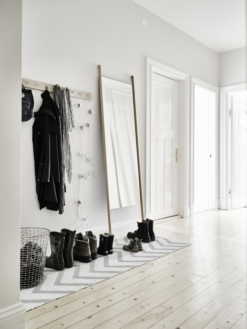 Interior Design Idea - What To Include When Creating The Ultimate Entryway // Decor -- add a mirror, some photos, some flowers, and maybe a lamp or some string lights, and your entry way will become a nice little place that greets you with beauty and style as you walk in the door.