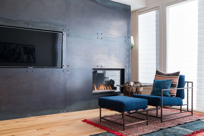 Fireplace Design Idea - 6 Different Materials To Use For A Fireplace Surround // A black steel fireplace surround gives a modern, industrial feel to a room. #FireplaceSurround #FireplaceIdeas #SteelFireplaceSurround