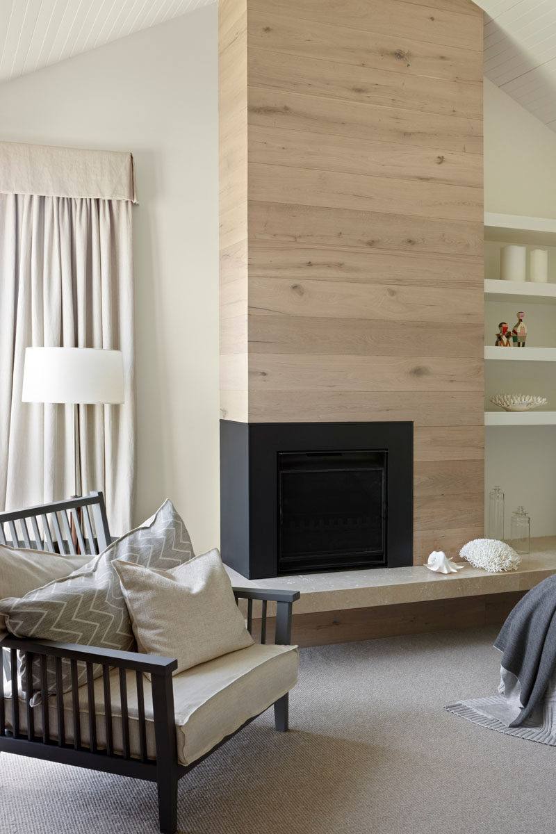 Fireplace Design Idea - 6 Different Materials To Use For A Fireplace Surround // A light wood fireplace surround contrasts with the black of the fireplace. #FireplaceSurround #FireplaceIdeas #WoodFireplaceSurround