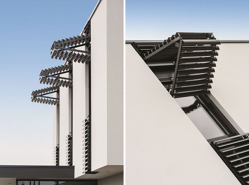 These window shutters open vertically instead of horizontally and provide a shade from the sun, and protection from intruders and the wind.