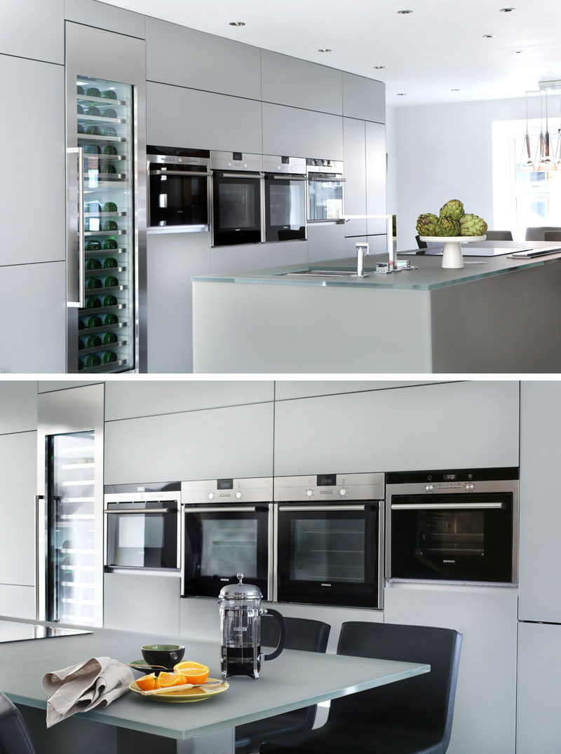 12 Examples Of Sophisticated Gray Kitchen Cabinets // A wall of light gray cabinets match the island in this kitchen.