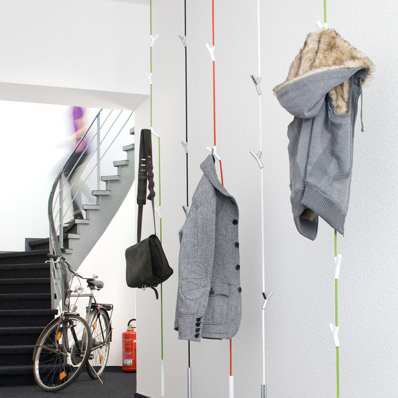 These hanging coat racks have 4 adjustable Y shaped hooks to hold your  coats and bags and a weight at the bottom to keep the rack from swaying too  much or ...