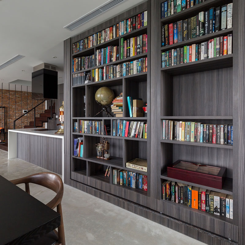 A secret guest bedroom/home office is hidden behind a bookshelf in this home.