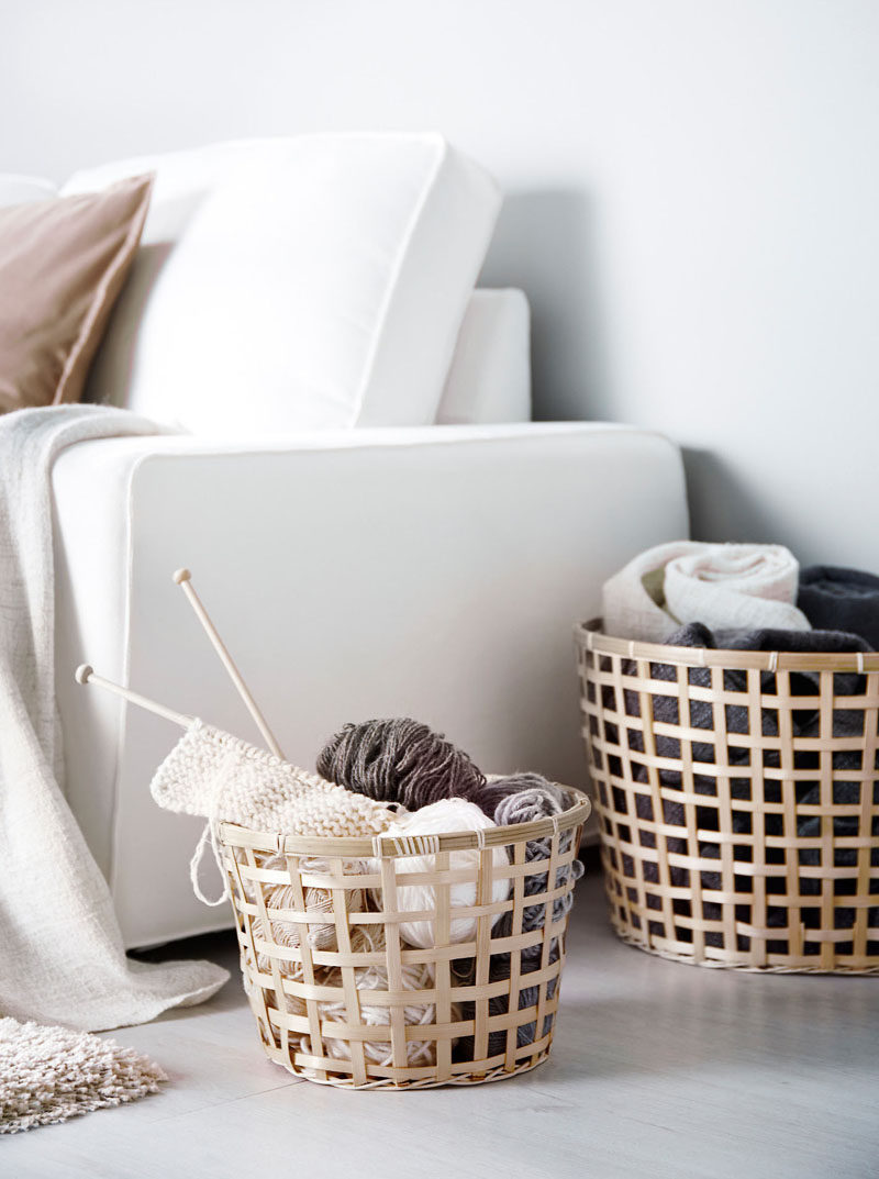Apartment Decor Idea - Decorate With Textiles // Baskets of blankets scattered around your apartment give you a convenient spot to store extra blankets, pillows, and other things you don't want to have lying around the apartment.