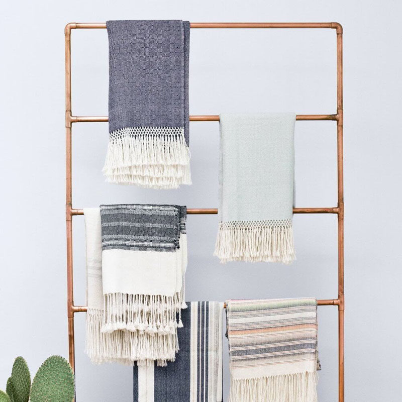 Apartment Decor Idea - Decorate With Textiles // A ladder full of blankets is another renter-friendly way to add decor to your walls without making any holes and creates a cozy warmth.