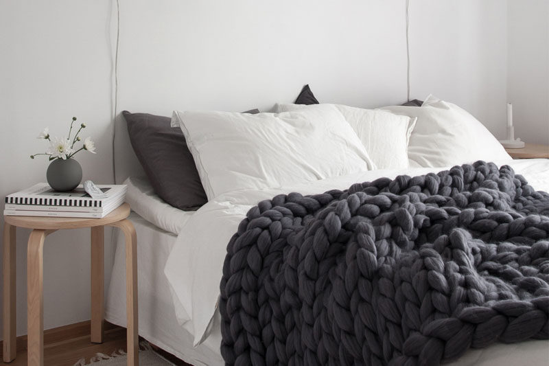 Apartment Decor Idea - Decorate With Textiles // Big chunky knitted blankets make a huge style statement and add texture to your space. Plus they'll keep you super warm all winter long.