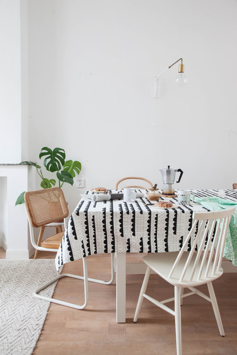 Apartment Decor Idea - Decorate With Textiles // Table cloths are another easy way to create temporary decoration. They'll protect your table from spills, liven up your apartment, and contribute to a cozy feeling kitchen.