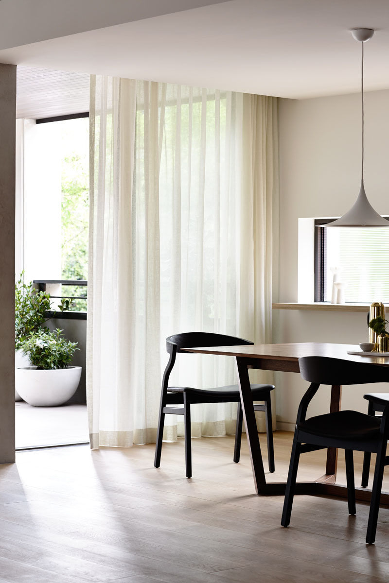 Apartment Decor Idea - Decorate With Textiles // Flowing curtains add a lightness and airiness while simultaneously adding warmth and comfort to an interior. They're easy to replace when you move out but can make a huge difference to the feel of the space while you're living there.
