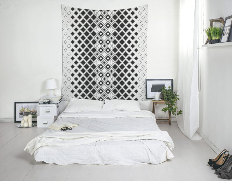 Apartment Decor Idea - Decorate With Textiles // Tapestries bring in color and warmth and are an easy way to cover up walls that you wish you could paint.