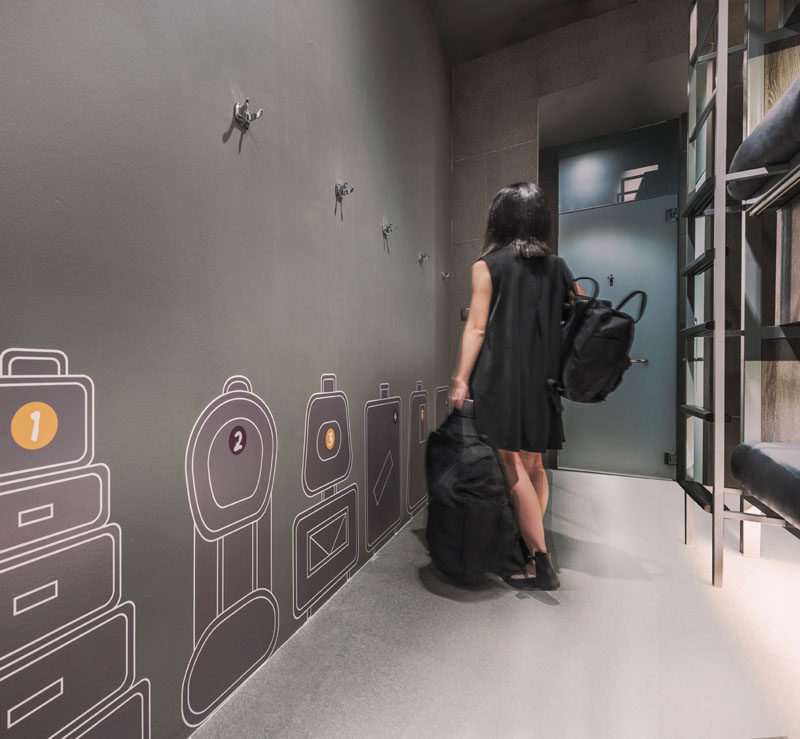 Wall graphics help guests to know where to put their luggage in this hostel.
