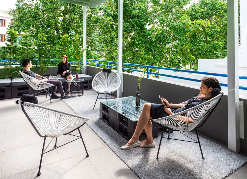 The private terrace of a hostel in Singapore has casual, relaxed seating.