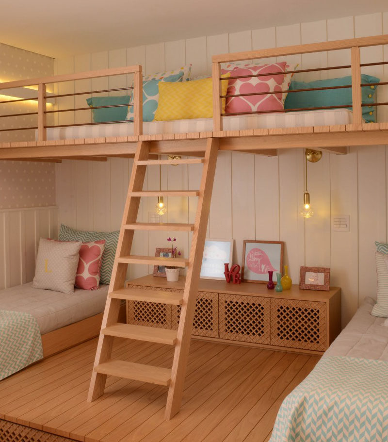 This cute girls bedroom was designed with a lofted play space.