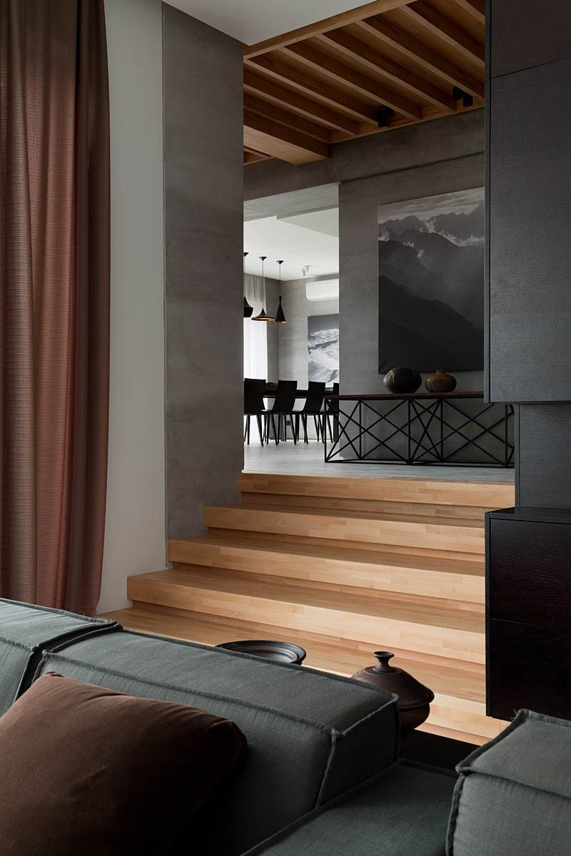 A palette of gray and walnut completes the redesign of this family home.