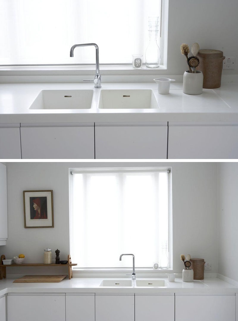 KITCHEN DESIGN IDEA - 7 Kitchen Sinks Integrated Into The Countertop // White countertops flow right down into the sink in this kitchen helping to maintain the clean look and feel.