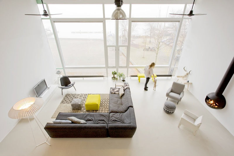15 Living Room Layouts From Above // This large, bright living room has been divided into two main areas - one for lounging on the couch and watching TV, and another quieter spot next to the fire perfect for cozying up with a book.
