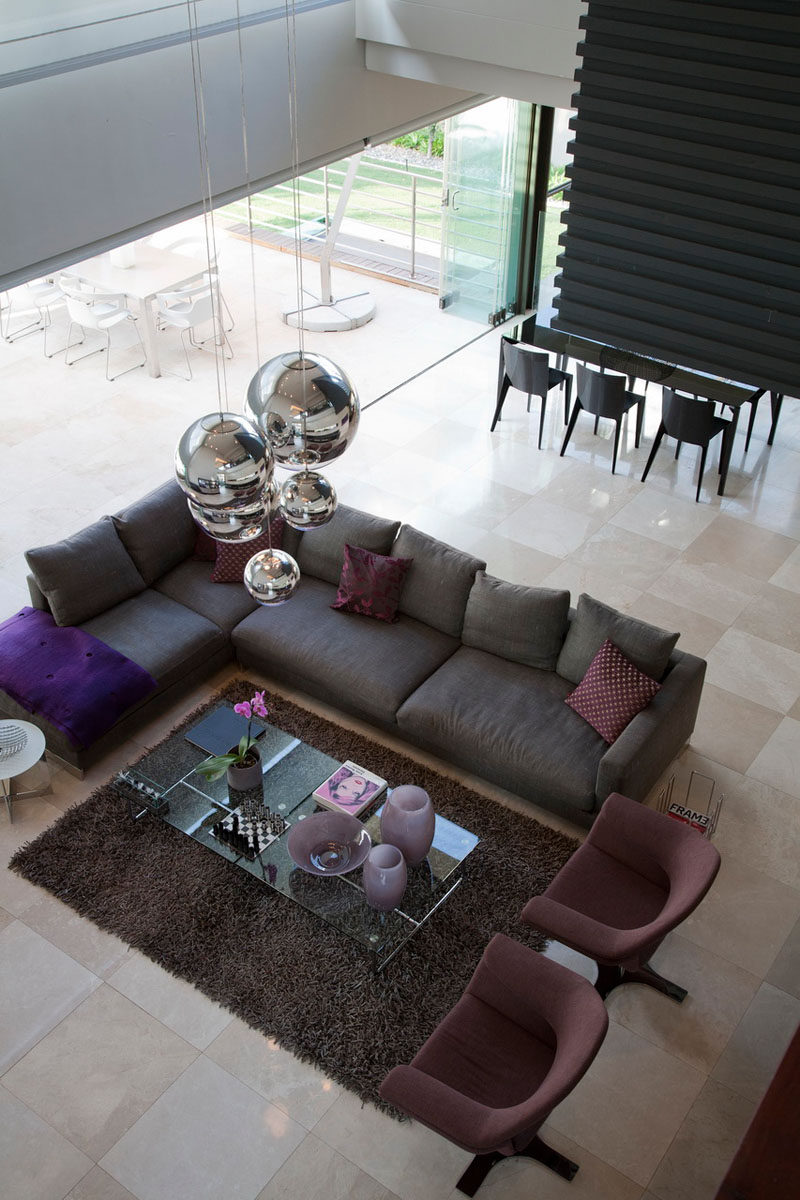 15 Living Room Layouts From Above // In an open floor plan, focusing the living room around a rug enables the sofa and armchairs to feel anchored in the space.