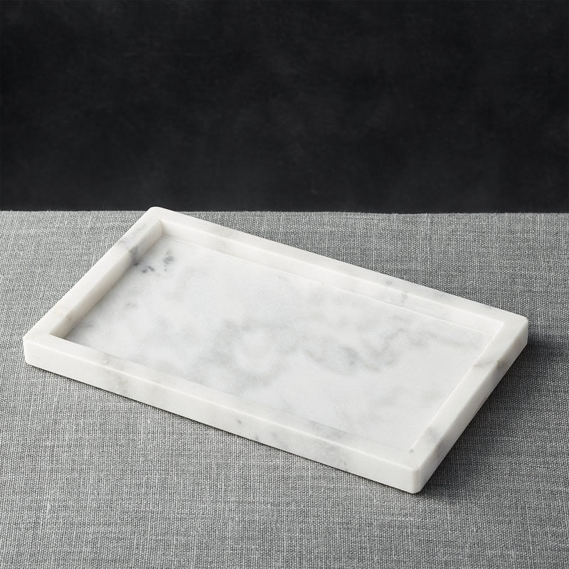 Office Decor Idea - Add A Touch Of Marble // Keep all of your important things gathered in one place with this elegant marble tray. It will help you make sure that you don't lose pens or pencils and will help make your desk feel all the more organized.