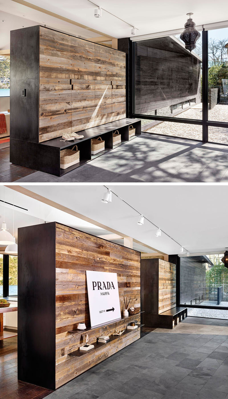 Room Divider Ideas - 10 Examples Of Multi-Functional Room Dividers // Splitting the living and kitchen areas from the entrance of this home are two custom made dividers that have plenty of storage both on and in them.